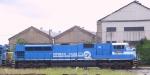 CSX 811 leads a train into the yard
