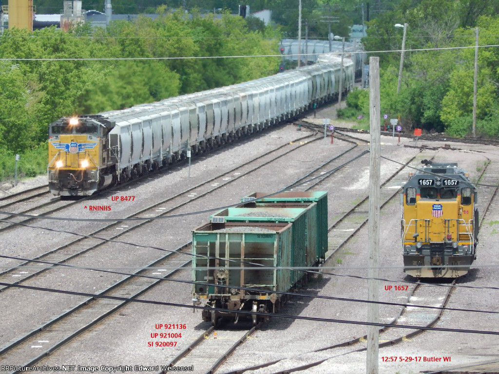 3 ballast cars are between incoming RNINHS sand loads and the sleeping Sd40N