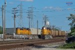 Cudahy local's GP60 crosses the Capitols to yard its 12 cars