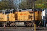 Dash 9 delivered as CNW 8719 brings up the rear of a 10-motor lash of zombied locos