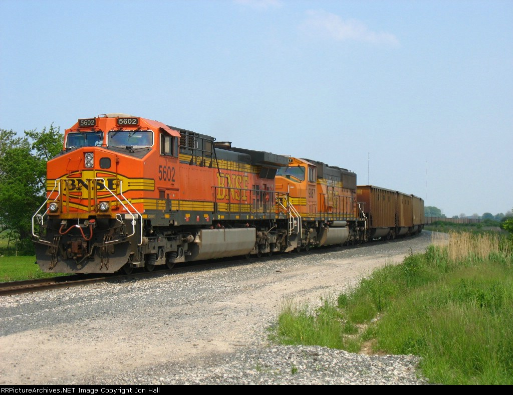 BNSF 5602 & 9887 waiting to go west with a 667 empty coal train