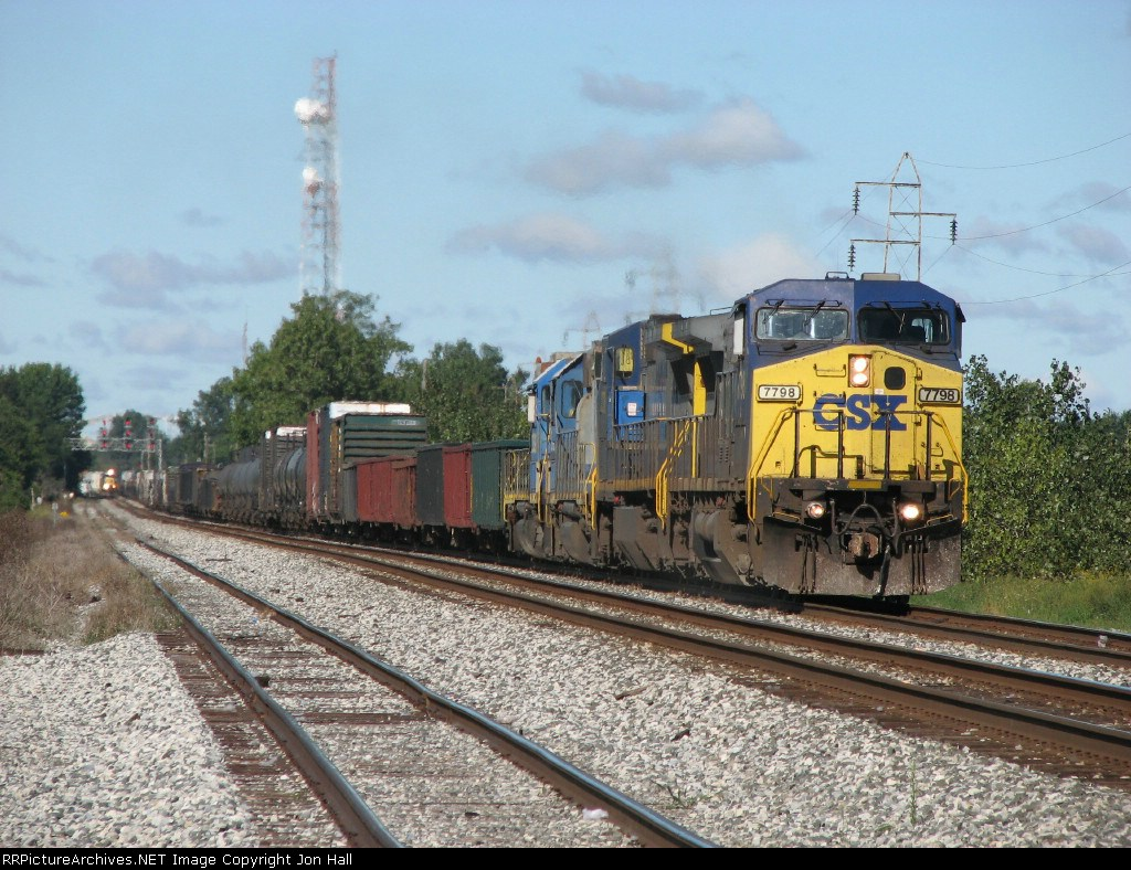 CSX 7798 starting Q394 down the B&O as Q634 comes off the C&O in the distance