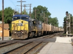 CSX 7809 leading K896-12 across the B&O/NKP diamonds