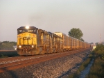 CSX 7344 leading Q276 eastward moments after sunrise