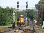 CSX 8594 leading Q394 under the old signal bridge on the C&O