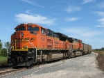 BNSF 9341 & 5661 waiting under a blue sky with a 616 loaded coal train