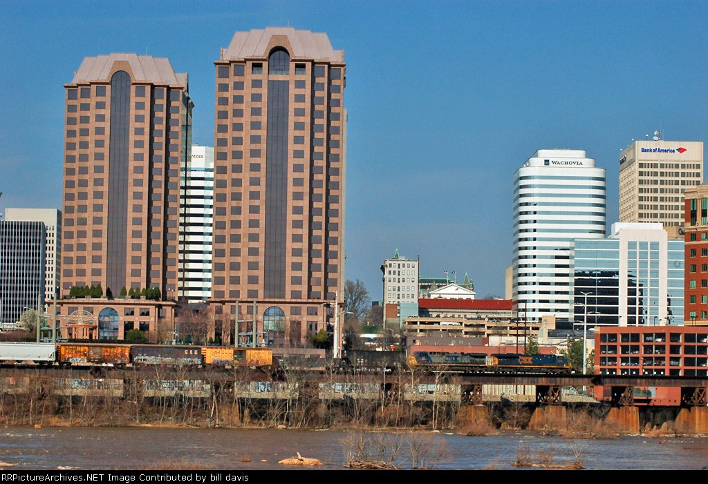 Q302 passing the river city towers