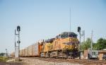 A northbound autorack train approches the BNSF diamond