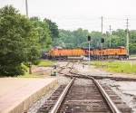 A BNSF train crosses the diamonds and turns left