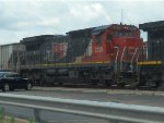CN C40-8 2128 trails on a northbound grain train