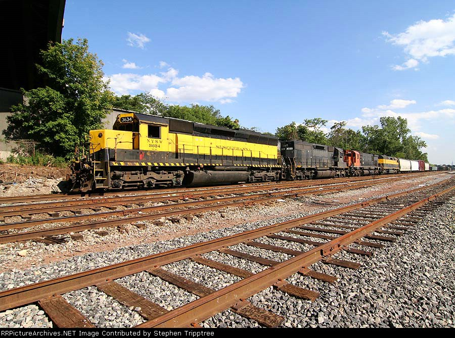 NYSW 3634/WS-4 backing its train thru the mc yard towards the scale