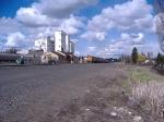 BNSF 4682 pulls a loaded grain train south