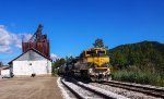 VTR 432 leads the transfer freight past the old feed mill in Mt. Tabor