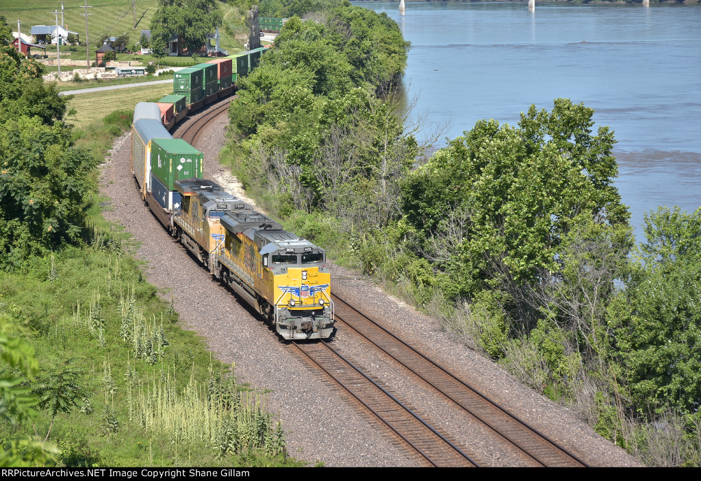 UP 8858 Leads a eastbound stack next to the Missouri river.