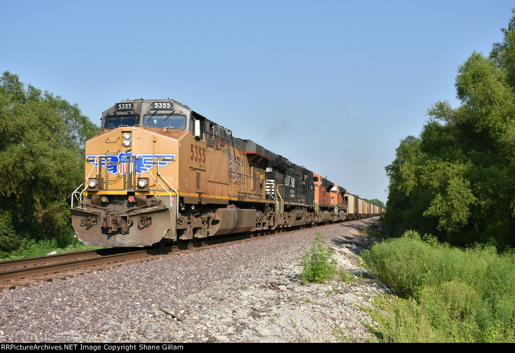 UP 5355 Races a mixed freight up the K line.