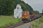 BNSF 7995 blast past a old elevator still standing tall on the K.