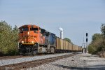 BNSF 9038 Races a empty coal past the power plant.