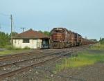 DM&IR 205 rolling by an abandon depot.