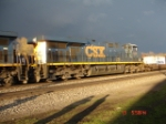 CSX 5255 (ES44DC) WB thru the sun and away from the storm