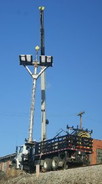 Headless signal mast lifted off its pedestal