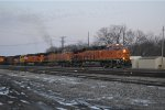 BNSF 8014 departs with the KCKTUL