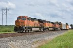 BNSF 3807 Races a freight west down the Marceline Sub.