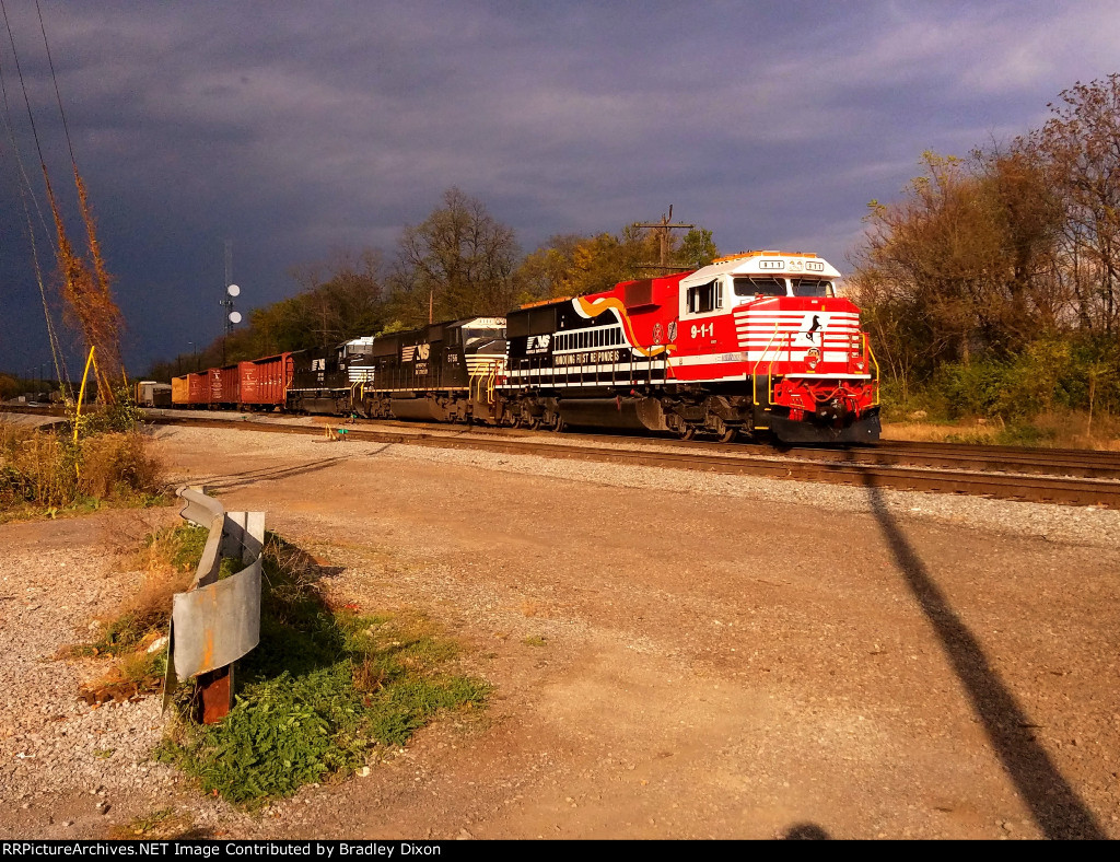 NS 911 leading 13R with storm clouds