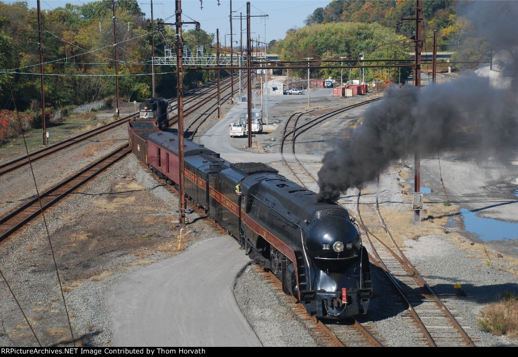 NS H14 passes through the former PRR Yard with N&W 611 in tow