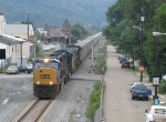 CSX 702 leads U994 eastward through town after swapping coal loads for empties at Colona