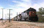 SP 9365 leads 80 645 cylinders east through Walnut CA.