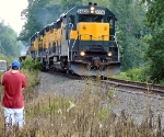 Railfan Ryan Parent photographs the J. E. Strates carnival train