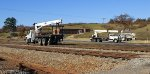 Hi-rail cranes are preparing to position themselves to remove old southbound signls at Hurt, VA.