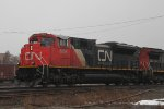 Mixed freight slowing to leave cars in the yard