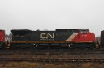 Mixed freight, second unit, slowing to leave cars in the yard