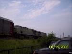 NS 7557 & 7527 both in primer, lead an eastbound autorack train