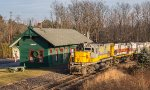 DL's Lehigh Valley heritage unit leads a heavy freight up-grade past the ex-DL&W passenger station in Cresco, PA