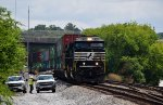 NS Train #282 rumbles past some track maintainers waiting for the right of way