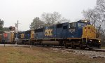 CSX SD60I 8730 and SD50-2 8524 rush past the Senoia Rd crossing