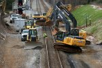 As soon a track time was given a hoard men and heavy machinery descended upon the right-of-way.
