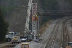 Signal Department prepares to dismantle the northbound signal bridge at former CP Smothers