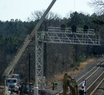 Horizontal portion of new cantilever at MP 212 is lifted into place