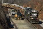 With Main #1 intact and in place now, ballast train 90J moves into position to dump rock