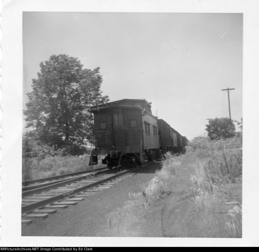 GM&0 Fulton Branch caboose heading South beyond GM&0 Engine house