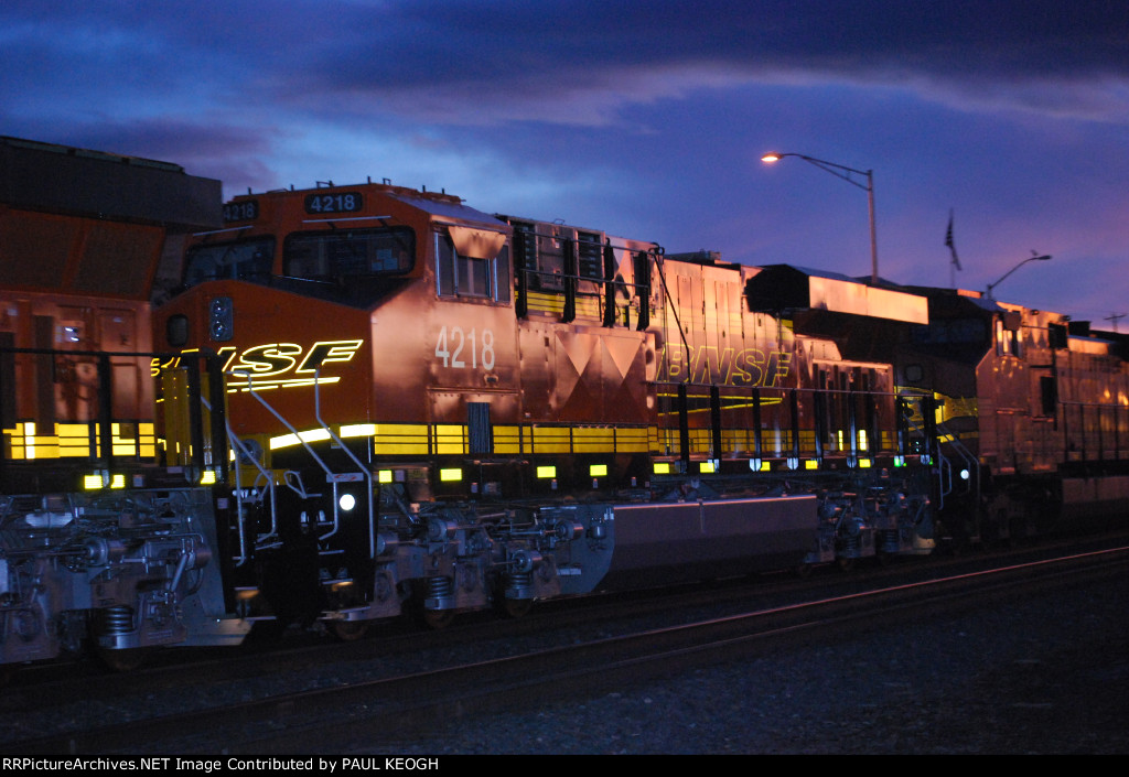 BNSF 4218 A Very, Very, Very Brand New ES44C4 TIER 4 Credit Locomotive Heads west as the #3 unit on A Westbound Stack Train at Dusk with Her Sister BNSF 4206 as the #4 unit in the Same Consist.