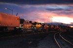 BNSF 4218 and BNSF 4206 Pull A Westbound Stack Train at Dusk Through Downtown Gallup, New Mexico as they Head towards BNSF Winslow Arizona for a crew swap.
