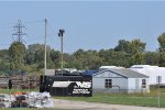 Old SD 70s Hoods & New UP AH In Primer & A ExPort In The Back yard