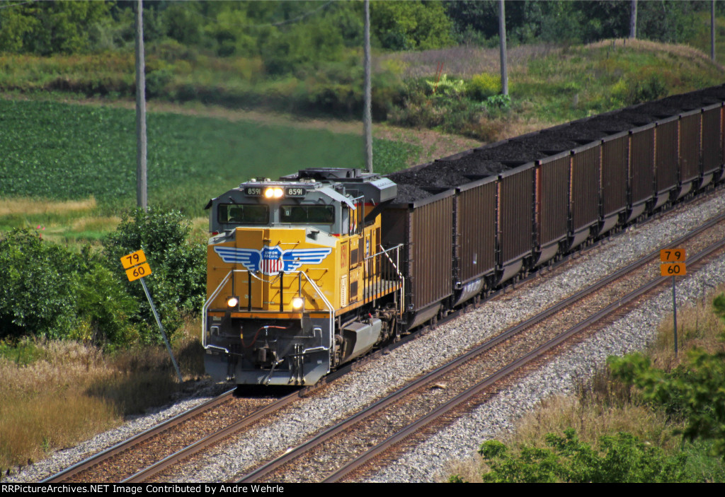 UP 8591 leads an 813 Columbia coal train, unusual for these parts