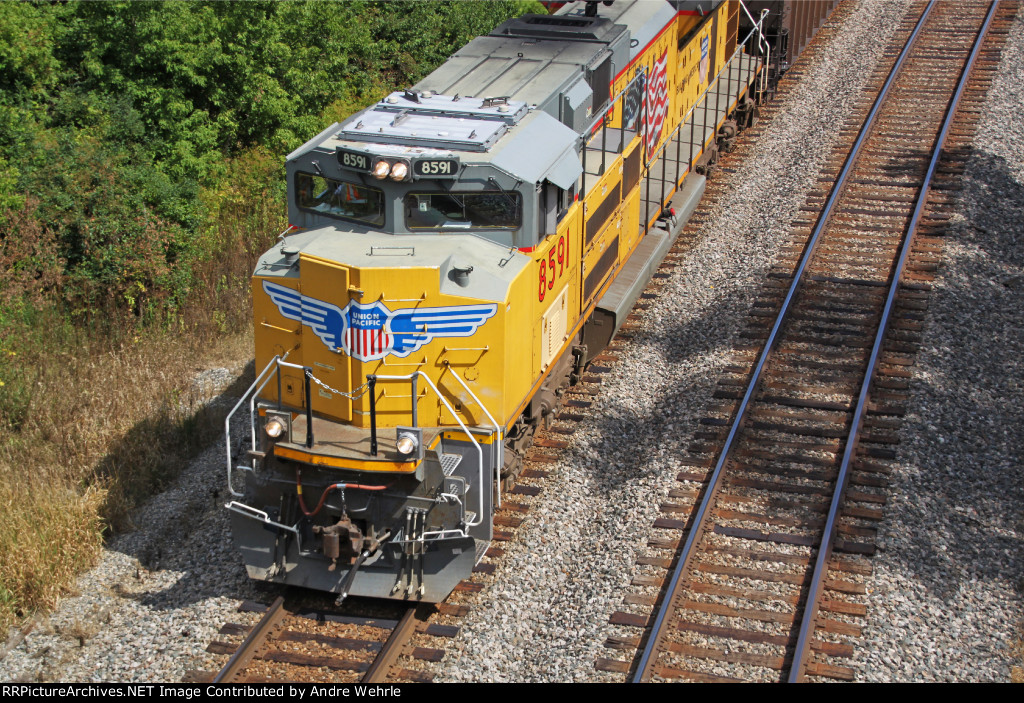UP 8591 about to dive under Sauer Road on the point of the coal loads