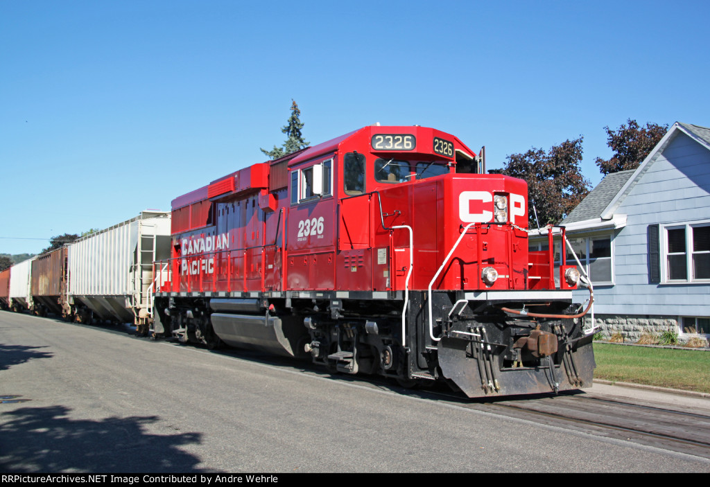 CP 2326 rumbles along the pavement of Wall Street
