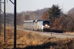 A three-headed No. 8 is almost 100 minutes late approaching its Portage stop